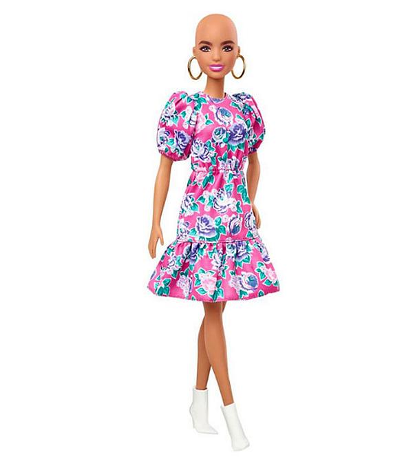 За да обогати линията, компанията създава и кукла Барби без коса.