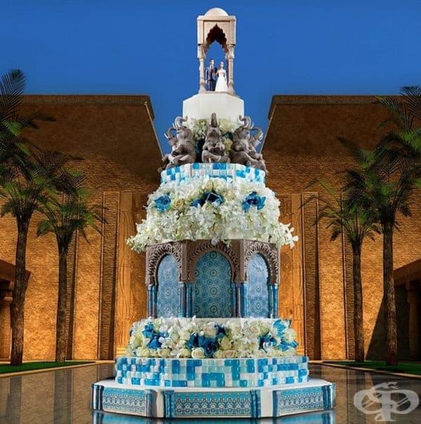 Мароко Всеки детайл от тази торта е страхотен: шоколадовите фигури, арките, колоните, цветята и оригиналния орнамент. Мароканският стил е представен от ярки цветове. Тортата е висока 1,7 м.