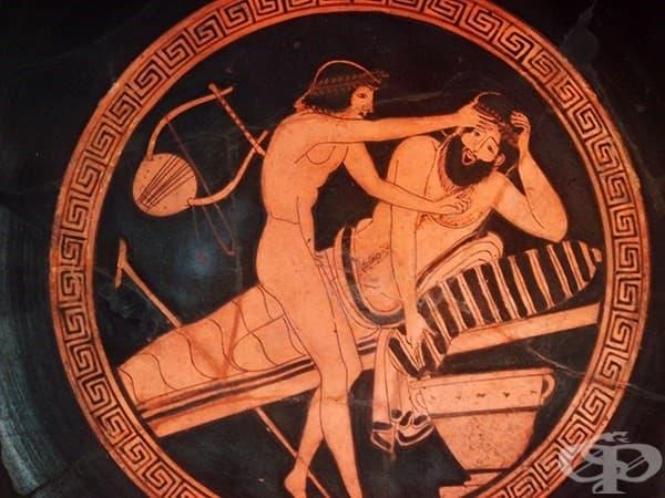 Роб помага на повръщащ пиян мъж по време на симпозиум – своеобразна вечеринка с много пиене и ядене на корем. 500-470 г. пр. н. е.