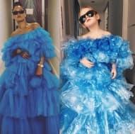 Момиченце пародира умело известни личности, облечено в рокли от подръчни материали