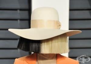 Кое е лицето, което стои зад черно-бялата перука на певицата Сиа?