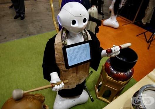 Робот заменя будистките монаси по време на погребения  - изображение