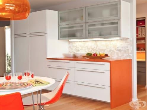 Стимулирайте апетита на злояди малчугани с оранжево в кухненския интериор - изображение