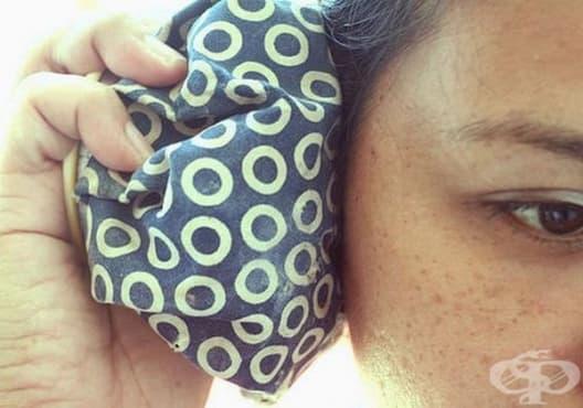 Приложете топъл компрес, за да облекчите болката в ушите - изображение